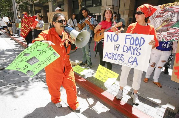 LOS ANGELES, CA-JULY 18, 2011:  Delores Canales, 52, of Santa Ana,  left, protests outside the Ronald Reagan State Building on Spring St. in Downtown Los Angeles on July 18, 2011, in support of the more than 6000 prisoners across the state who have participated in an indefinitie hunger strike since July1.  Her son, John Martinez, 35,  is currently in a prisoner in the Pelican Bay  Security Housing Unit and is one of the hunger strikers.  The prisoners are on strike to bring attention to the conditions of their confinement. (Mel Melcon/Los Angeles Times)